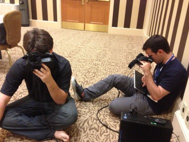 Oculus VR co-founders Palmer Luckey, left, and Nate Mitchell, right, calibrate Oculus Rifts before a demo at PAX.