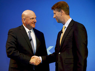 Microsoft CEO Steve Ballmer and Nokia Chairman Risto Siilasmaa shake on the $7 billion deal.