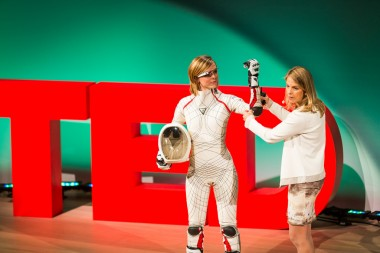 MIT professor Dava Newman (at right) shows off a prototype skintight space suit
