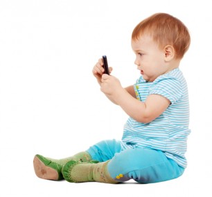 toddler on phone shutter stock Iakov Filimonov