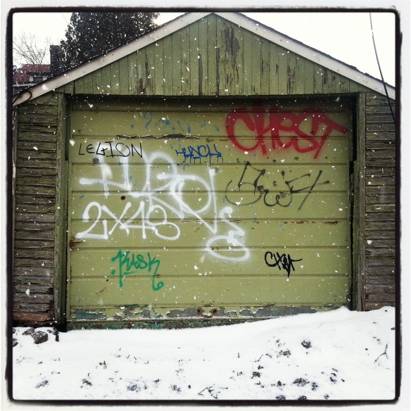 Graffiti-covered garage in alley