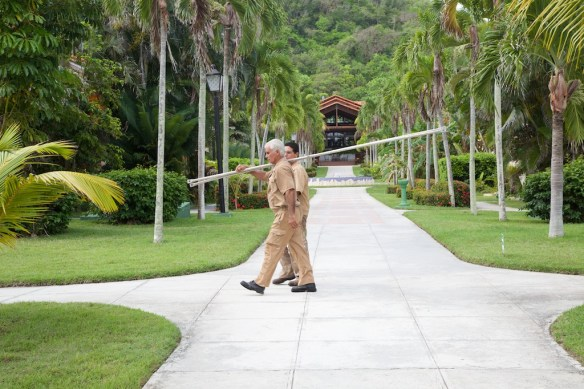Gardeners on path by main building