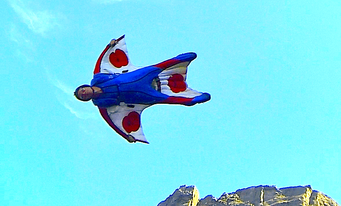 Alastair Macartney makes a U-Turn while flying his wingsuit in Kjerag, Norway.