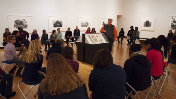 Museum director John Stomberg speaks to a class about the Kara Walker exhibition.