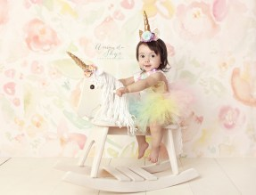 Amanda Skye photography, child photography, OC children photographer, Orange County child photography, Orange County Photographer, rainbow tutu and unicorn crown, unicorn rocking chair, unicorn cake smash, unicorn 1st birthday
