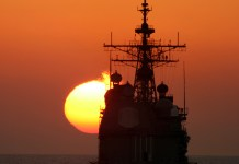041109-N-0000X-001 Strait of Hormuz (Nov. 9, 2004) Ð The guided missile cruiser USS Hue City (CG 66) transits into the Arabian Gulf through the Strait of Hormuz at sunset. Hue City is assigned to the Expeditionary Strike Group Three (ESG-3) led by the amphibious assault ship USS Saipan (LHA 2) in support of Operation Iraqi Freedom. U.S. Navy photo by Cryptologic Technician 3rd Class Clayton S. Reyes (RELEASED)