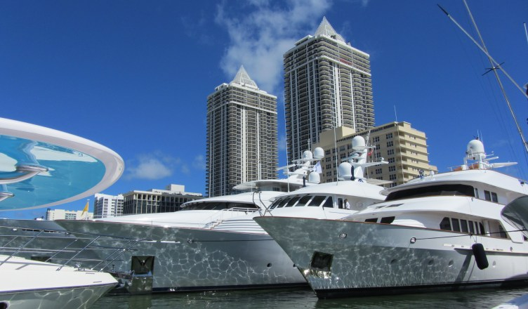 Amethyst Condominium Miami Beach walking distance to boat show mega yachts at base of blue green diamond buildings on Indian Creek River
