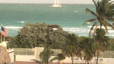 Amethyst Condominium Miami Beach unobstructed ocean view passing sailboat blue green ocean tradewinds