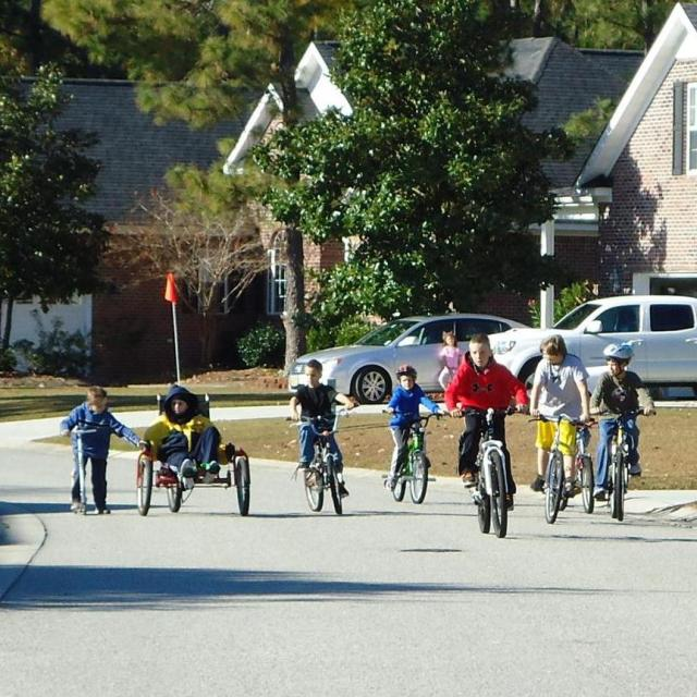 Random ride through the neighborhood with friends...Zack on his special bike and Nick giving a little push.