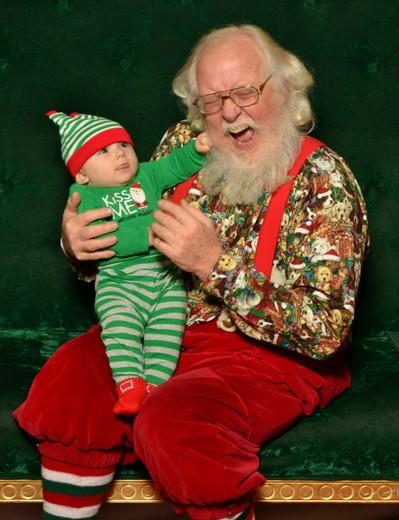 Baby pulling Santa's Beard