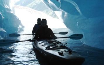 Kayaking through a glacier tunnel.