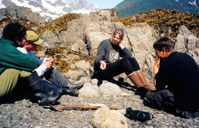 Guides Paul Nylund, Ehren Wierner and Mary Smith learn about the intertidal zone of PWS