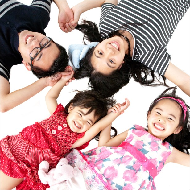 Portrait of an asian family from above professional studio photography by Anais Chaine in Auckland Ponsonby New Zealand