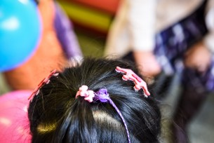 Little girl with brooches on her hair
