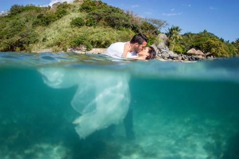 Couple over under water split shot at Castaway island in Fiji