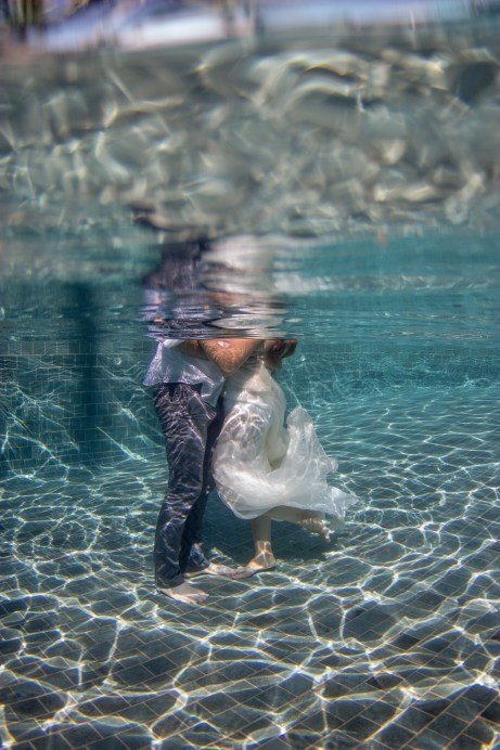 Couple kissing in the pool for their trash the dress photoshoot in Fiji at Castaway island resort