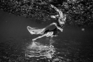 Black and white and upside down woman underwater in Fiji by Anais Photography