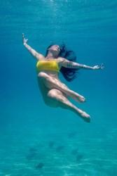 Woman posing underwater in Fiji