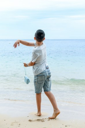 Boy by ocean in Malolo Island Resort Fiji