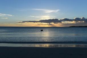 Boat floating against the stunning sunset in Natadola Fiji
