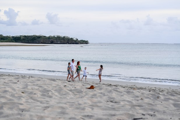 Wideshot of Family playing on the beach in Fiji family photoshoot