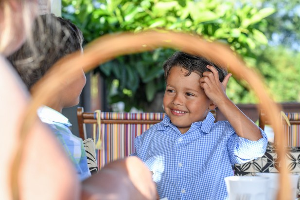 Young Polynesian boy scratching his head