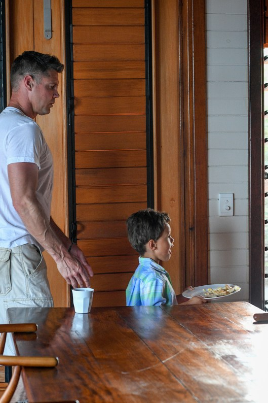 Father and son leave the breakfast table during Fiji family vacation