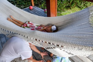 Triplets flip dad over on hammock during Fiji family vacation