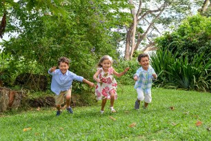 Triplets run on lawn in Family vacation Fiji
