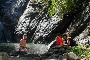 Children watch dad swim in river at Fiji