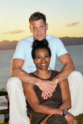 Portrait of mixed race Polynesian an caucasian couple against stunning Fiji sea and sunset