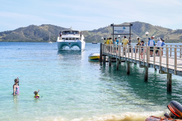 A cruise ship arrives at the dock at Plantation Island Resort Fiji