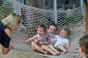 Three babies are fitted onto a hammock