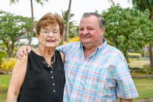 The matriarch and patriarch of the extended family pose for a picture