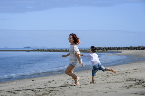 Mother and son play on the beach at Natadola Fiji
