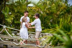 Children tickling eachother. Candid photoshoot in Fiji.