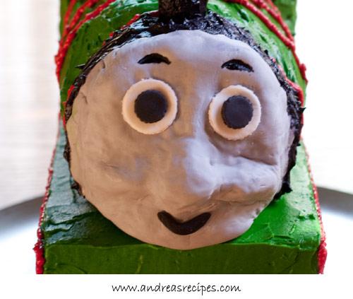 Andrea Meyers - Percy Train Birthday Cake face