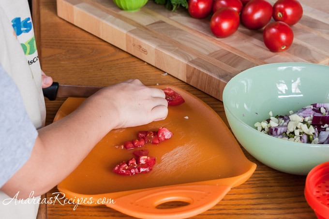 Andrea Meyers - Dicing tomatoes for salsa fresca.