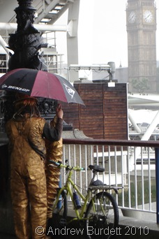 Street artist taking shelter _ Southbank
