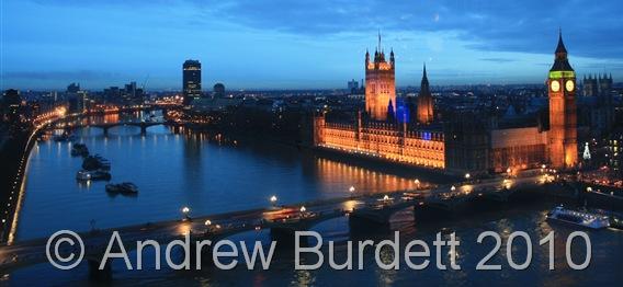 POWER_Parliament illuminated at dusk.