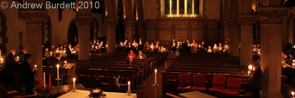 CHRISTINGLE CANDLELIGHT_With the church's lights dimmed, each Christingle shone bright.