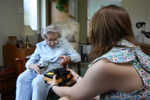 GIVING THE GIFT_Harriet passes Dorothy her Easter gift from the five of us.