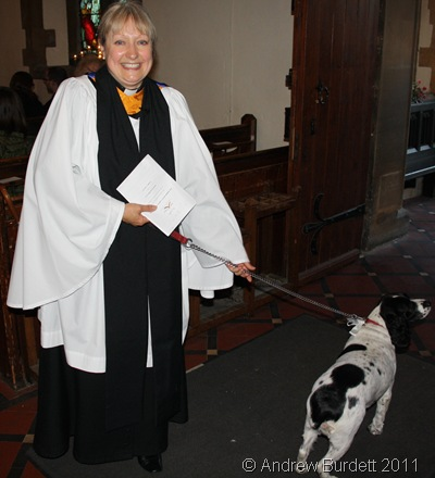 LADY'S BEST FRIEND_Sally with her dog at the door, just after the service.