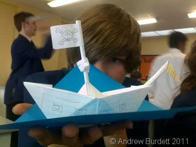 Zac Brooke holds an origami boat he made in a science lesson, after the batch of exams in May 2011