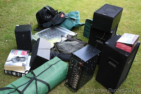 BOXES OF TRICKS_The many speakers, microphones, cables, and laptops.