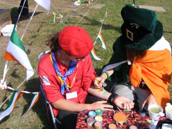 IRISH PAINT_An Irish leprechaun paints an Irish flag on a youngster's arm.