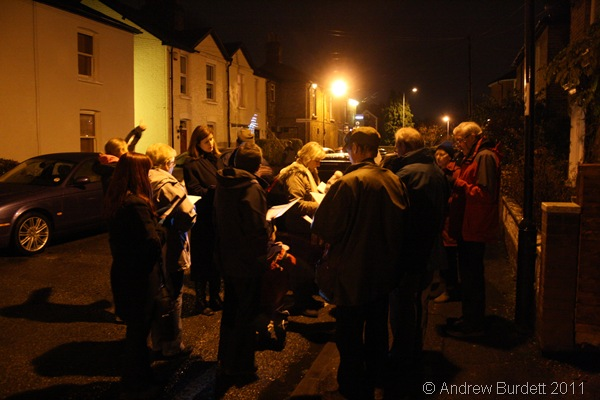 HUDDLED ROUND A LAMPOST_After leaving Neve House, we sang carols in the neighbouring streets.