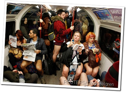 KNICKERS IN A TWIST: Londoners travelling on the tube wearing no trousers.