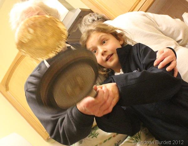 CAREFUL: A schoolgirl tosses a pancake. (IMG_8327)