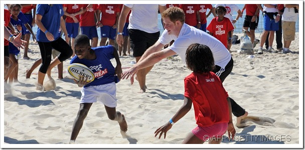 HAVING A BALL: Prince Harry plays sport with Brazilian children on the Rio de Janeiro beach.